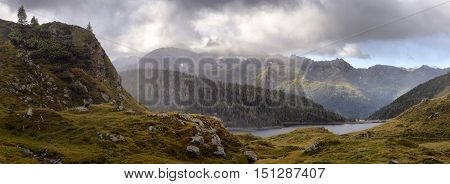 mountain landscape with a lake at dawn in the Alps
