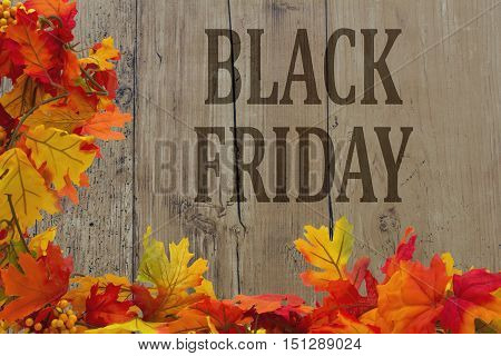 Black Friday Shopping Autumn Leaves with grunge wood with text Black Friday