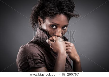 Portrait of a sensual young African woman. Picture with high contrast effect.