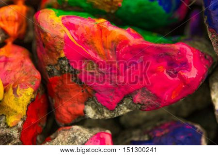the paint on the surface of the stone close up