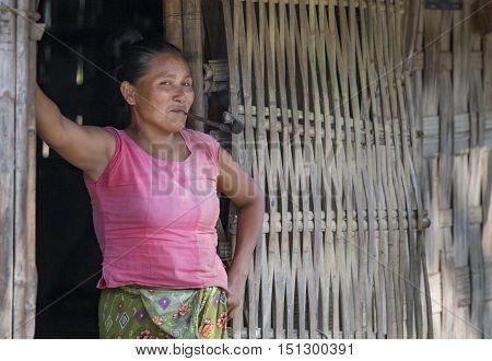 Chittagong Bangladesh February 25th 2016: bangladeshi woman smoking a pipe