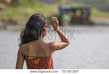 Chittagong Bangladesh February 25th 2016: young bangladeshi woman in a river