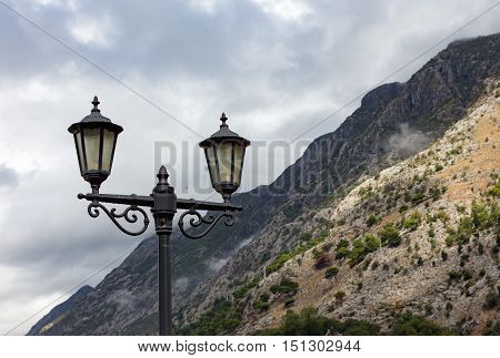 lantern streetlights on a background of mountains