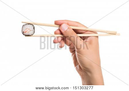 Close up of sushi roll held with chopstick isolated on white background. Man holding sushi roll in chopsticks. Male hand holding chopstick to eat sushi isolated on white background.