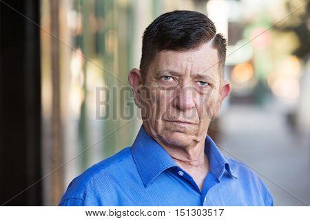 Serious Transgender Man Standing Outside