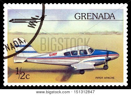 STAVROPOL RUSSIA - October 10 2016: a stamp printed in Grenada shows plane Piper PA-23 Apache circa 1976.