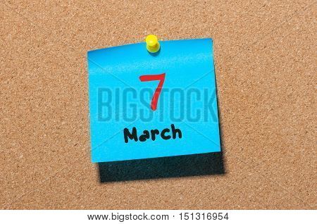 March 7th. Day 7 of month, calendar on cork notice board background. Spring time, empty space for text.
