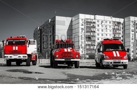 red fire engines on black white photo