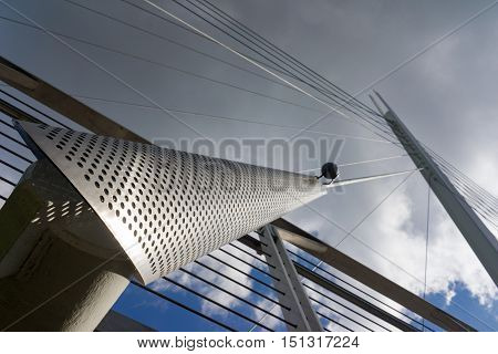 The modern contemporary lines and curves of the Christchurch footbridge over the River Thames at Reading in Berkshire.
