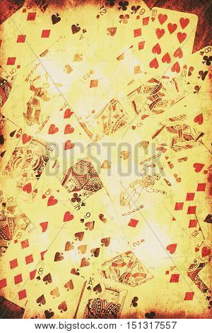 Light beaming on various scattered vintage playing cards. Wild west card games