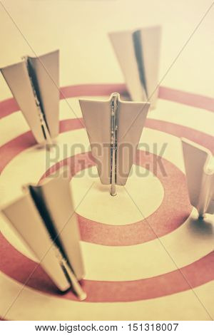 Metal paper airplane arrow darts to hit right target sign business aims and smart solutions concept