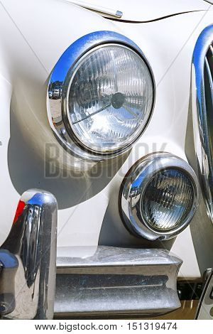 round headlight of the vintage car. auto, automobile.