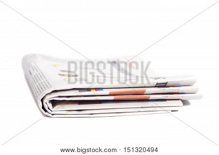 Folded newspapers on a white isolated background