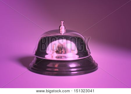 Service bell button on a purple background