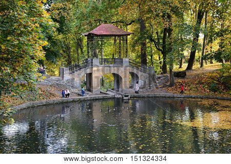 BILA TSERKVA UKRAINE - OCTOBER 6: The Chinese Bridge in Olexandria Park and visitors on October 6 2016 in Kerkyra Greece. More then 12 mln tourists is expected to visit Ukraine in year 2016.
