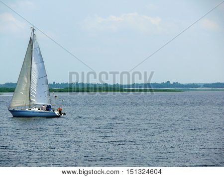 a Sailingboat on a lake at sunny day Ukraine