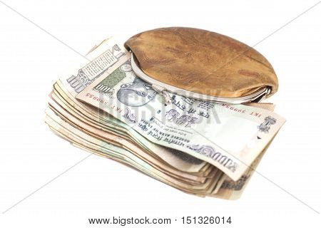 Wallet with Indian currency notes isolated on white