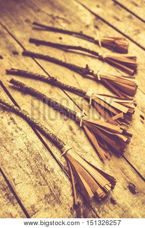 Old wicked witches broomstick laying parked on wooden planks. Gathering of Salem witches