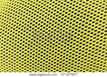 The colored yellow abstract background mesh checkered. Light green nylon texture designed as net