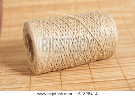 Skein of jute twine on wooden background