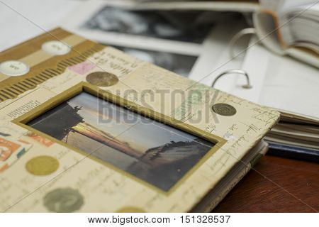photo albums that are lying on a table