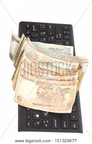 Money Indian Currency Rupee Notes on computer keyboard isolated on white