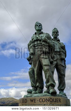 SPEAN BRIDGE SCOTLAND - 1 Oct 2016: United we conquer. Close up of the three uniformed servicemen of Commando Memorial of the cast bronze sculpture dedicated to the British Commando Forces who trained here in WWII.