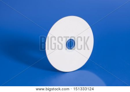 Compact CD disk on a blue background