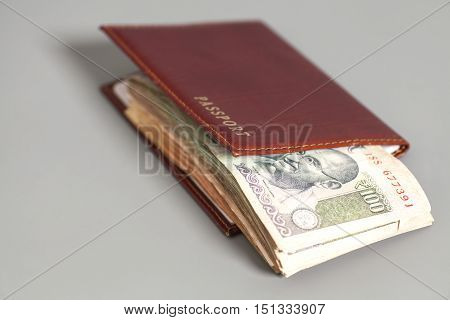 Indian Currency Rupee Notes and Passport on gray background