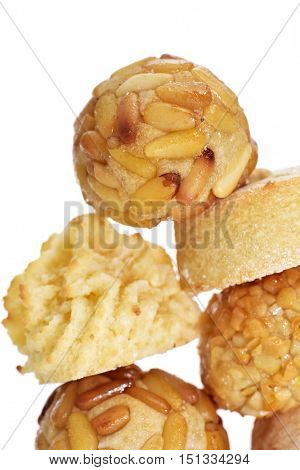 closeup of some panellets, typical confection eaten in All Saints Day in Catalonia, Spain, on a white background