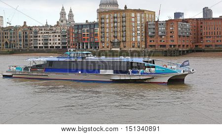 LONDON UNITED KINGDOM - NOVEMBER 20: Thames Clipper Monsoon in London on NOVEMBER 20 2013. Thames Clipper Fast Catamaran Boat at River Thames in London United Kingdom.