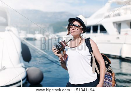 Woman With Vintage Camera At Sea Harbor