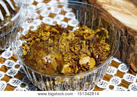 Propolis in the form of a sphere and its pieces. Natural product.