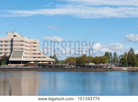 Embankment in the city of Vyborg. View the Drakkar of Vikings