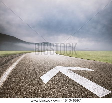 Road with arrow drawn on asphalt. Concept of way of the success