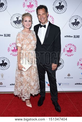 LOS ANGELES - OCT 8:  Maureen McCormick and Michael Cummings arrives to the Carousel of Hope 2016 on October 8, 2016 in Hollywood, CA