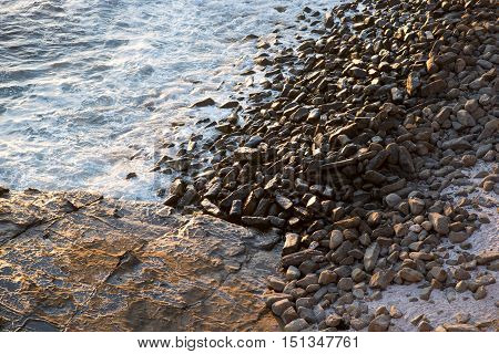A photography at the beach of Rocks, water, and sand textures.