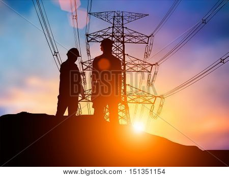silhouette The young engineer was thinking to comply with environmental construction and the environment around us and have a minimal impact on the public over Blurred Pole high voltage transmission lines