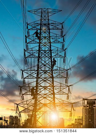 silhouette engineer repair and electrical installation work on high voltage pylons over Blurred construction site.CSR ESG Business on industry People Science Technology Transportation concept.
