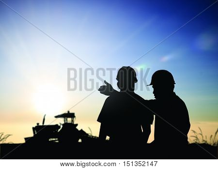 silhouette man survey and civil engineer stand on ground working in a land building site over Blurred construction worker on construction site. examination inspection survey