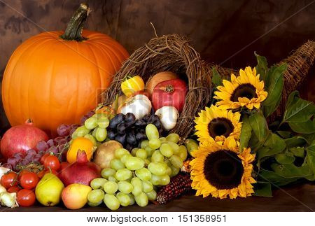 Healthy fruits. Pumpkin and sunflowers for Thanksgiving Season