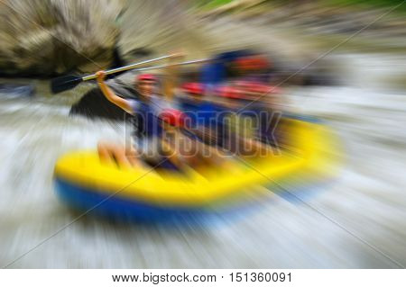 Rafting in the canyon on Balis mountain river Ayung at Indonesia blurred in postproduction
