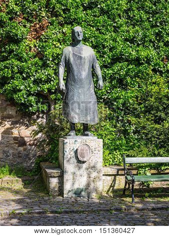 Wurzburg Germany - May 22 2016: Bronze monument for Johann Georg Oegg Residence Palace Wurzburg Germany. He was court locksmith and ornamental metal worker (1703-1782).