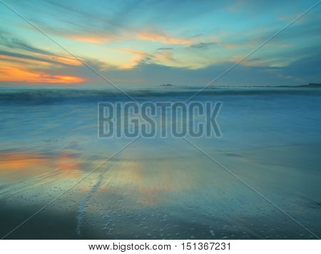 Abstact photo of wave movement on a beach at sunset