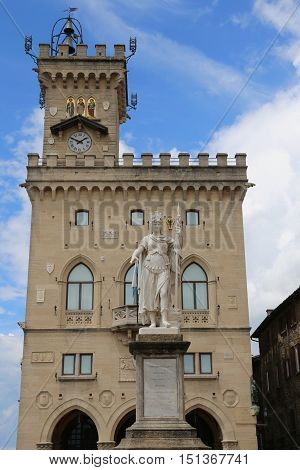 Statue of Liberty in the main square of microstate of San Marino and the ancient palace called Palazzo Pubblico seat of Government