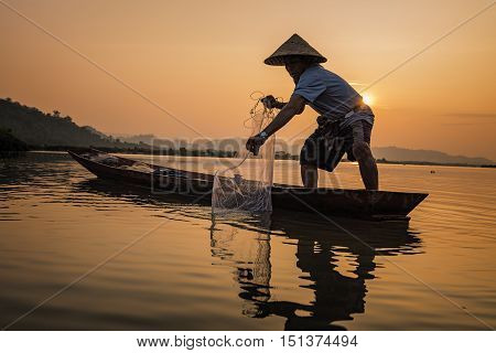 Fishermen fishing in the morning at the river.