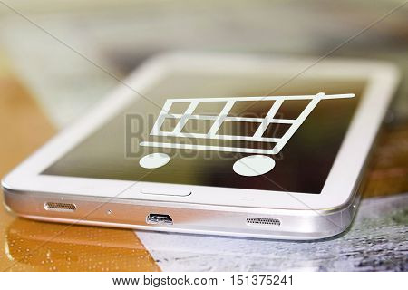 The shopping cart on the cell phone screen . The concept of online trading and online stores .