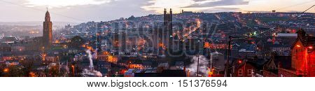 Aerial view of St. Anne's Church and Cathedral in Shandon Cork Ireland. Mountains and sunset cloudy sky
