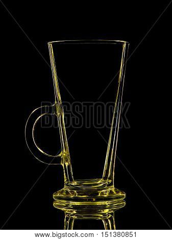 Silhouette of yellow glass for shot with clipping path on black background.