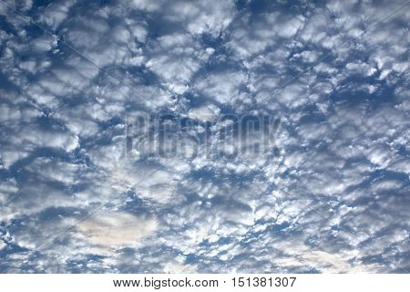 crowded white clouds in blue sky, can use as background